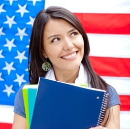 Female student in front of American flag