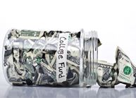 College fund jar tipped over with money coming out